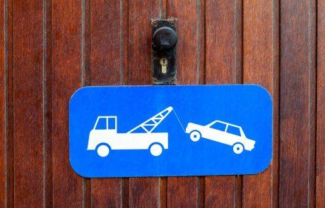 Een wagen blokkeert mijn garage. Wat kan ik doen?